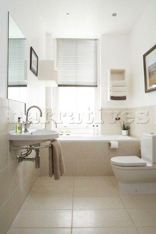 Neutral stone wall and floor tiles bathroom pinterest for Neutral bathroom tile designs