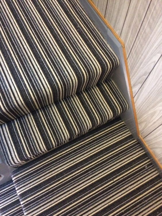 Monochrome colour Nylon striped Carpet gives these stairs a great Contemporary look!