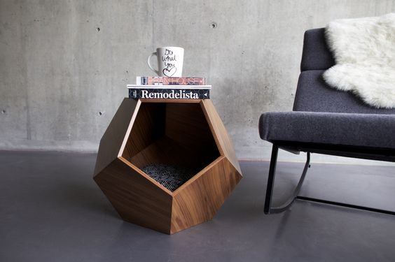 Modern geometric cave for dog  http://www.homedit.com/simple-wire-dog-crate-for-your-pet-friend/