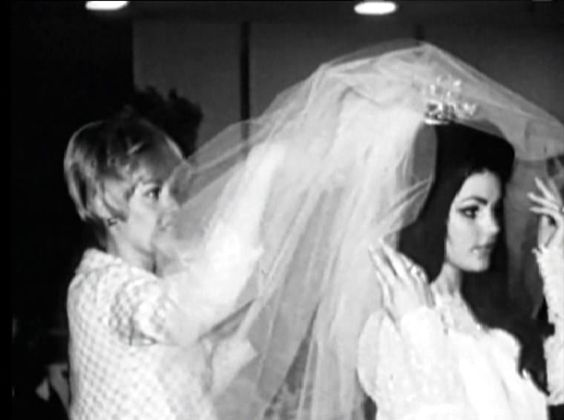 Joan Esposito helping Priscilla with her veil: