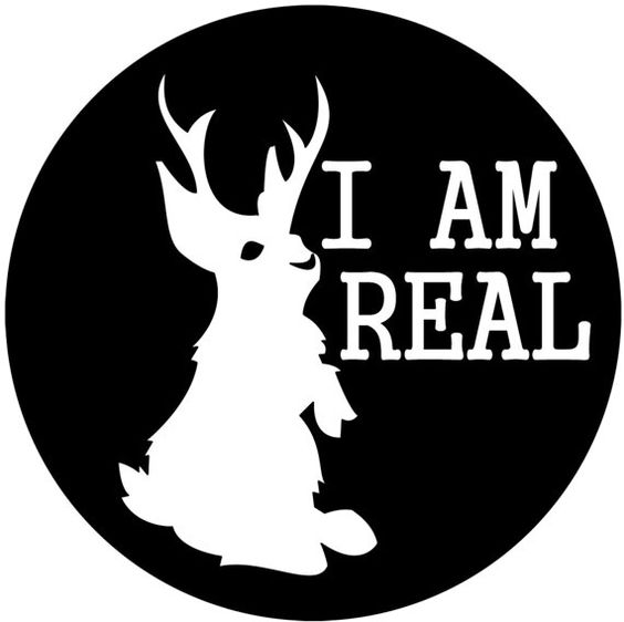 "The I AM REAL cryptozoology jackalope logo featured on a 3.5"" vinyl sticker.:"