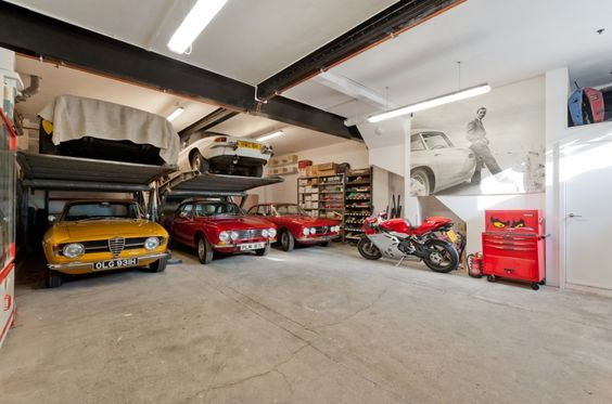 Awesome cars at a home garage we find better parking for Limited space storage solutions