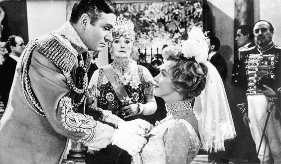 """Marilyn Monroe, Laurence Olivier and Dame Sybil Thorndike in a scene from """"The Prince And The Showgirl"""", 1956."""