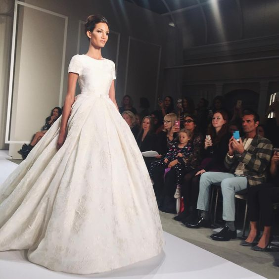 """Wow, we're head over heels in love with this @dennisbasso ballgown #weddingdress! #BridalFashionWeek  : @lisagooder #BridesFashionWeek"""