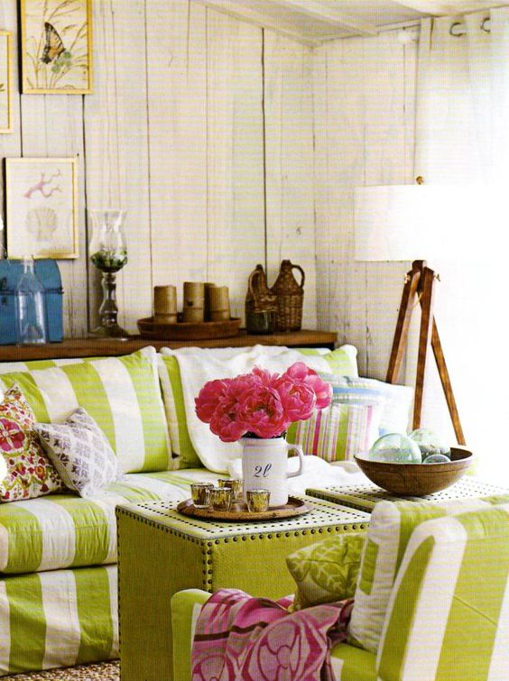 Lime and white living room.  Love the shabby walls, and pink flowers <3
