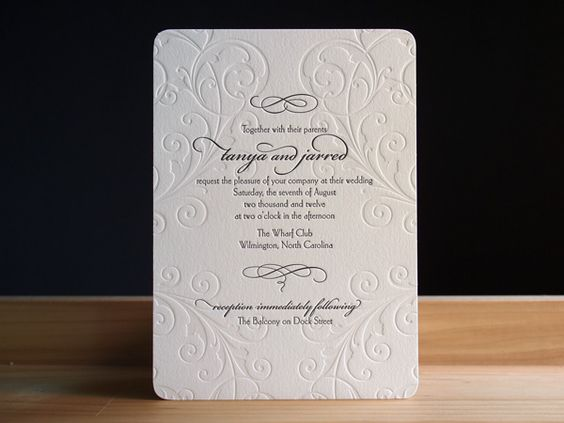 """Carlton from Parklife Press - embossed designs, black and white. Imagining different sized cards, featuring information on each unique wedding event, all in a single large envelope. The envelope may be all black, or all black with a gold wax stamp with the words """"you're invited"""" on it."""