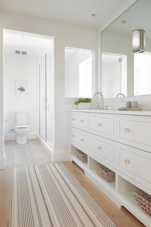 Contrasting Floors Play Up The White Walls And Accessories In This Transitional Bathroom To Create A Si Bathroom Remodel Cost Bathrooms Remodel Bathroom Design