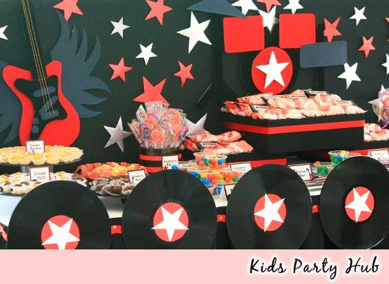 Rock and roll party ideas adults kids party hub rockstar themed candy and dessert table - Rock and roll theme party decorations ...