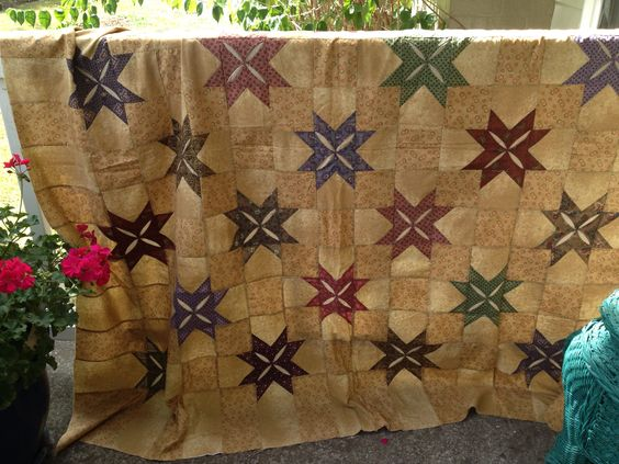 Quilting buddy, Val and l did this Cathedral Window quilt with Chris Calerios. It was a great day and my first quilt in reproductions fabrics..