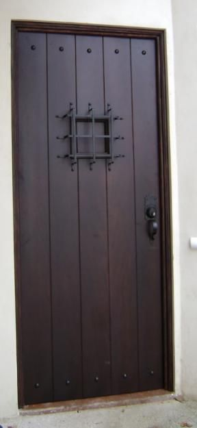 Puertas de metal mas seguras y se ven como de madera for Estilos de puertas metalicas