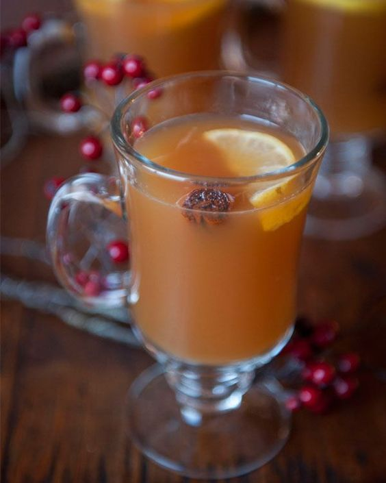 Hot Toddy with a Twist: 8 oz whiskey (or bourbon / brandy), 6 T honey, 2 lemons, 4 c apple cider, 4 earl grey tea bags, 4 cinnamon sticks. In a small pan over med-low heat, heat the cider, cinnamon, honey, and whisky until hot, stirring to dissolve the honey. Remove from the heat, add the tea bags, and steep for 2 minutes. Remove the tea bags and squeeze in the juice of half a lemon. Pour into four glass mugs. Garnish with the cinnamon sticks and some lemon slices cut into half moons.