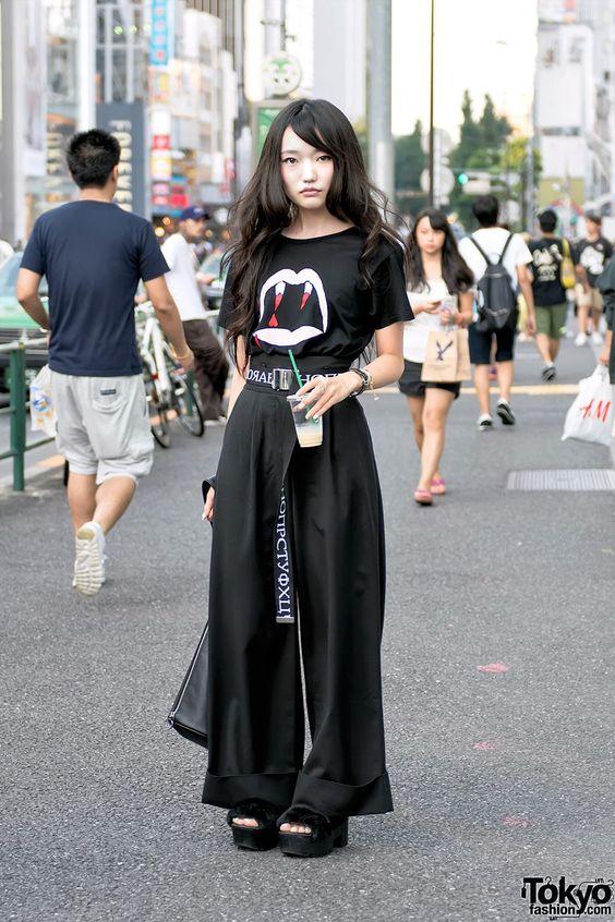 Haruka on the street in Harajuku today wearing a Saint Laurent vampire shirt, G.V.G.V. belt with Emoda wide leg pants, Pameo Pose platform sandals and vintage handbag. Full Look