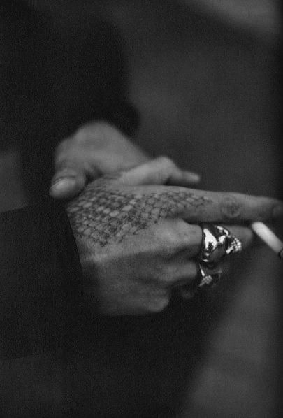 very clever, snake skin tattoo on hands