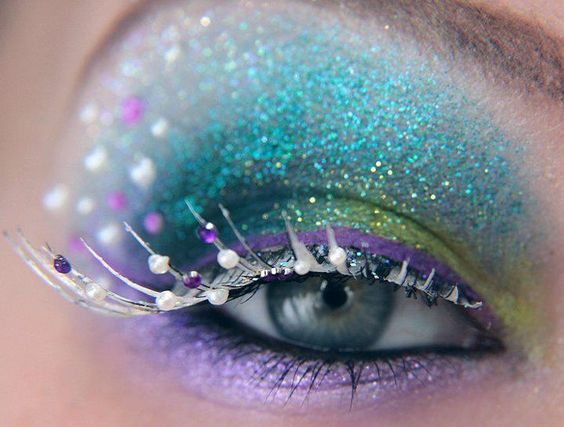 Glitter peacock makeup - Blue, green, yellow, purple eyeshadow with highly embellished eyelashes