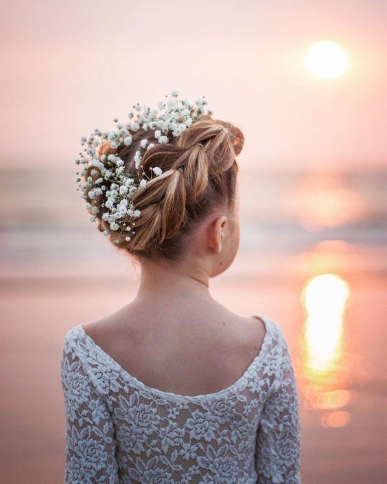 Pull through crown braid with flowers by @abellasbraids