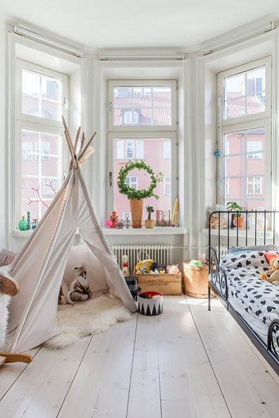 an adorable room with a teepee & a view..