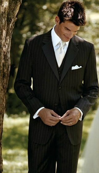The pinstripe of this groom's/groomsmen's suit takes the traditional away and brings in the modern.