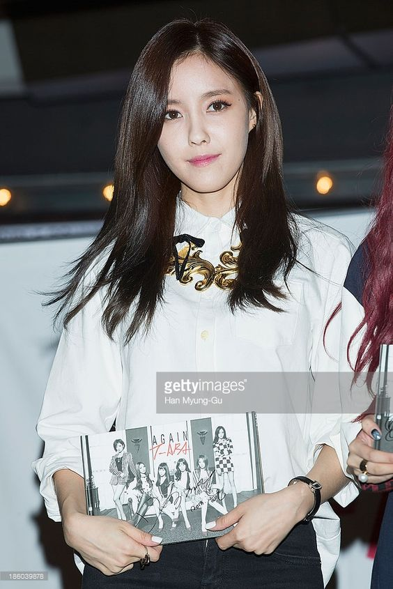 Hyomin (Hyo-Min) of South Korean girl group T-ara poses for media at their 8th Mini Album 'Again' record release signing at IFC Mall on October 27, 2013 in Seoul, South Korea.
