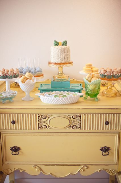 Hobnail vases and bowls atop a vintage dresser - love the colours and feel of this baby shower!