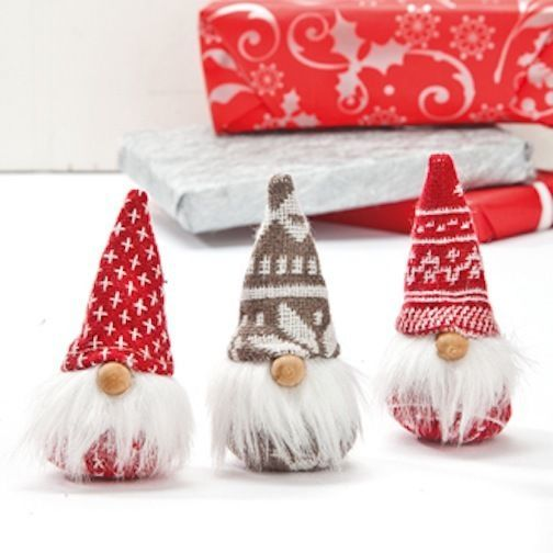"""Scandinavian Ornaments. THREE adorable Gnomes ! One of each style shown. Made with knit hats & bodies, wooden nose & furry white beard.  They feel like a bean bag inside. They measure 3 1/2"""" to the top of their hats."""