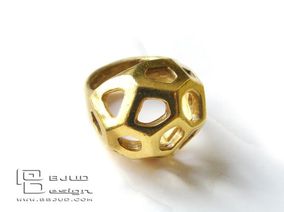 honeycomb ring  This is a sterling silver ring gold plated with 22 kt