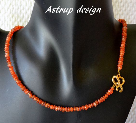 Very feminine little necklace.    Beautiful orange carnelian stones of 4 mm with a cute gold plated heart lock, chain measures 48 cm