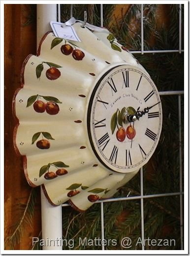 A cake tin has been hand painted and turned into a clock! This was for sale at a Christmas market at Lille, France.: