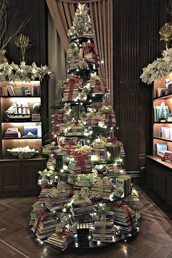 Book tree featuring altered book art is included in a round up of images from Longwood Gardens 2018 holiday display, Trees Reimagined #bookart #paperornaments #handmadeornaments #LongwoodGardens