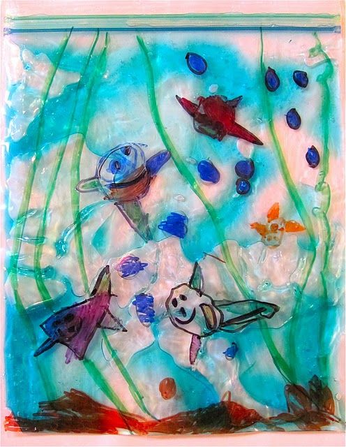 We made plastic bag aquariums!  This is such an incredibly easy project and FUN too! All you need is a plastic bag with a zipper top,  permanent markers, and some hair gel.  There is something satisfying about squooshing your fingers across the gel!