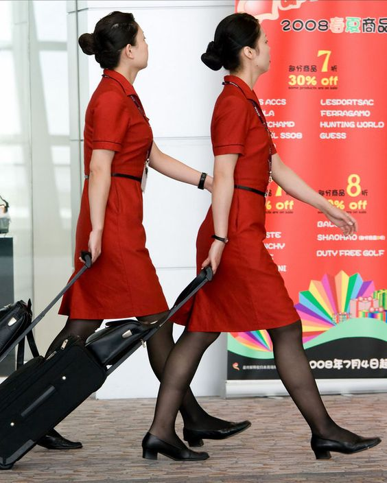 Air Macau stewardesses not stopping to talk to the press, despite apprehending two cocaine smugglers on board their flight to Shanghai. The two crew had caught the men with the drugs in the toilet, and after initial denials, the men were forced to admit what they were doing, and surrender. The women confiscated the drugs, then securely bound the two smugglers, and held them prisoner until landing, when they handed them over to police.