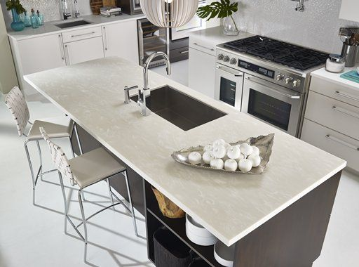 Bertch Cabinetry Kitchen Featuring Island In Corian