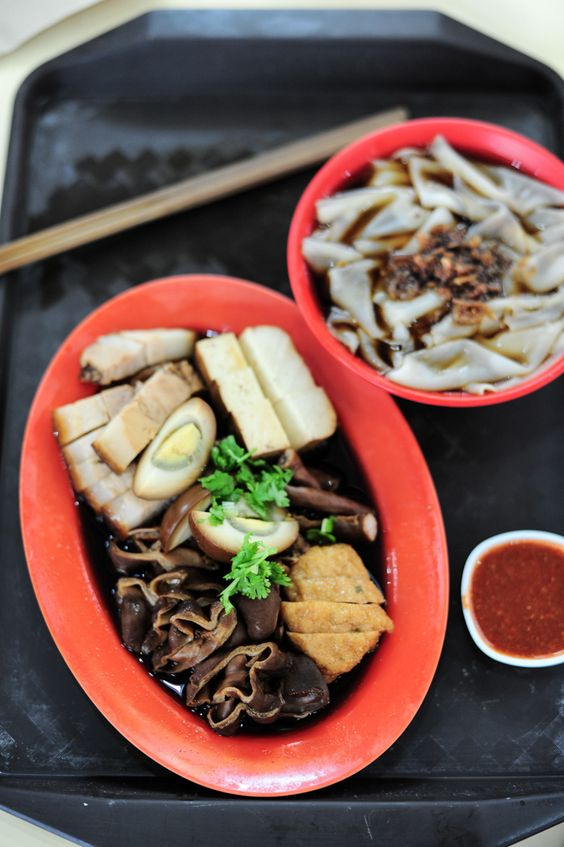 Another must-try dish in Singapore. Kway Chap is one that might intimidate foreigners, for it includes a multitude of ingredients – mostly intestine from a pig. The 'Kway' refers to thick cut flat noodles or kway teow served in a herbal broth, and 'Chap' refers to the braise sauce.