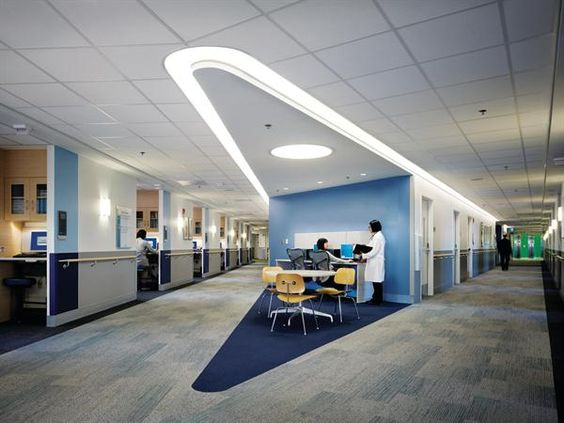 Nurses stations anchor each arm of the buildings patient-room floors. Cove lighting from Philips is inscribed into the ceiling to echo the overall building form.: