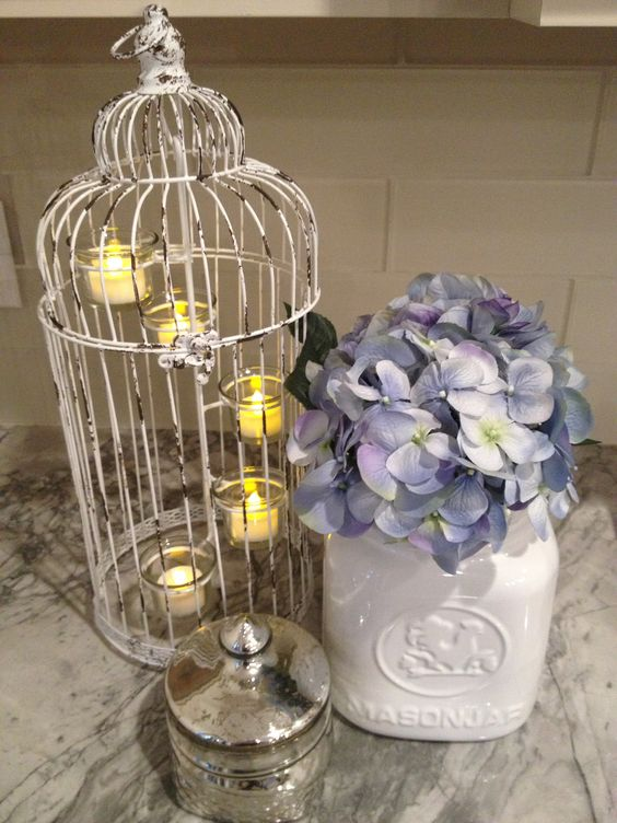 Vintage birdcage candle holder, white rustic milk vase, hydrangeas and silver antique tin = home decor perfection!