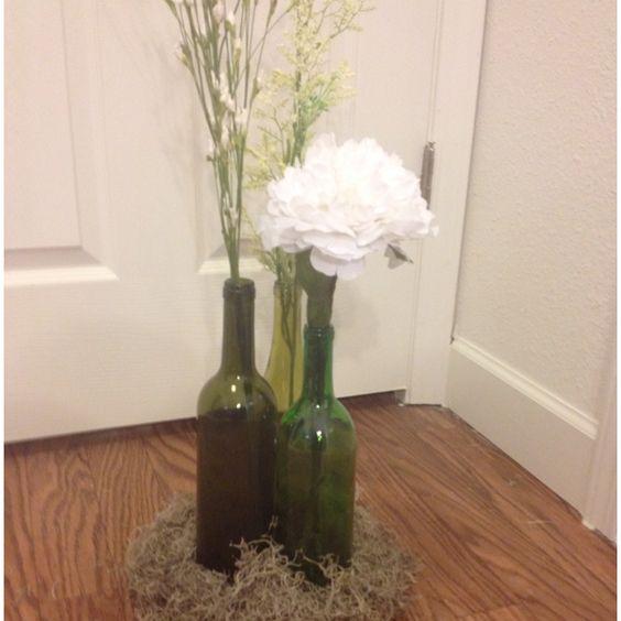 Wine bottle centerpiece - different flower heights