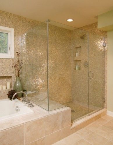 Shower with seat, glass enclosure, fully tiled, separate tub. Gorgeous! Perfect!