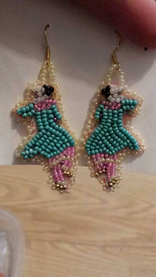 Smoke dancer earrings,  found on Facebook.