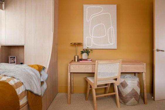Embrace colour in 2021. We bring you 3 interior design trends we predict are set to hit big in 2021. This year is a all about warmth, as seen here with this stunning mustard yellow wall from Three Birds Renovations. Paired witha timber desk, timber rattan chair and mustard accented bedding, it's a sure fire hit for kids and parents alike. Click the image for more on interior design trends for 2021.
