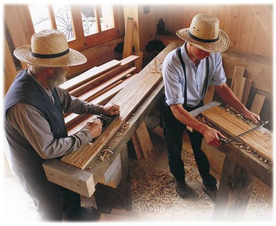 An Older Amish Man, And A Younger One, Work On Making Something Out Of  Lumber. The Pennsylvania Amish, Make Beautiful Tables, Desks, And Many  Otheru2026