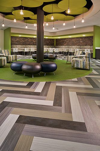 bright pops of green floor covering enliven this corporate office space and add texture to the bright modern office space