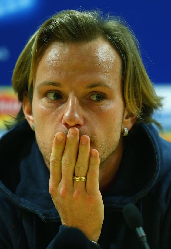 Ivan Rakitic looks on during a FC Barcelona press conference ahead of their UEFA Champions League round of 16 first leg match against Arsenal at the Emirates Stadium on February 22, 2016 in London, United Kingdom.