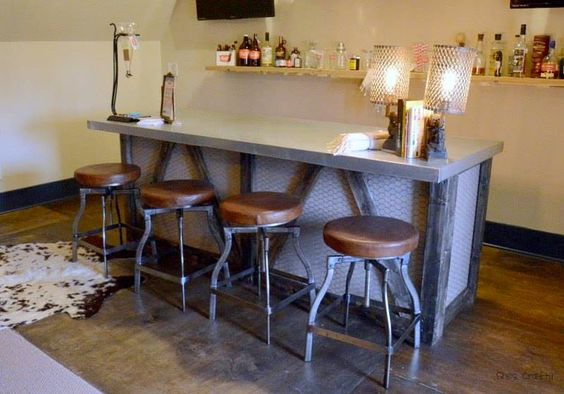 Casually Chic Bar Area in French Chateau Style House Love the chicken wire on the bar