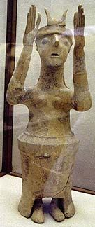 Goddess with horns. The clay bell shapee of these shrine figurines suggest their association with fertility. These figurines are numerous, like the snake goddess figures.