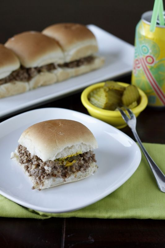 Famous Krystal Burgers Copycat Recipe:   What you'll need:  1 pound ground hamburger meat  1 envelope Lipton onion soup mix  1 cup mayonnaise  1 cup cheddar cheese – shredded  yellow mustard  dill pickle chips  dinner rolls. What to do:   1. Preheat oven to 350 degrees. Into a deep sided pan brown your hamburger meat. Remove from heat. Drain excess fat. [Continued below]