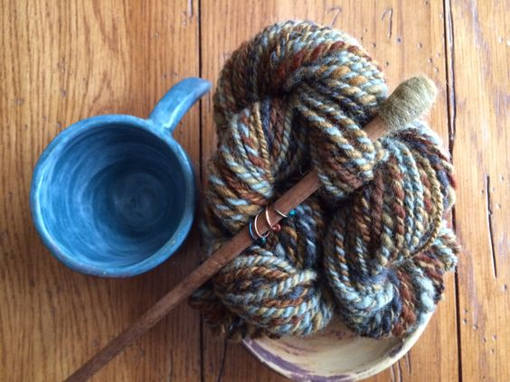 Handspun alpaca yarn with matching stitch markers and antique knitting needles