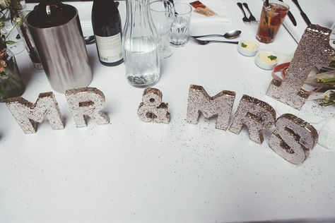 Gold glitter Mr & Mrs sign and table numbers | Photography by http://www.philippajamesphotography.com/
