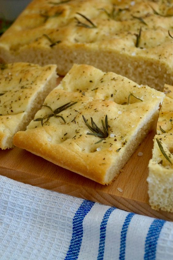 Traditional Italian focaccia. Fluffy olive oil bread topped with fragrant rosemary and sea salt flakes. There really is nothing better than homemade bread. Freshly baked, it always tastes amazing. ...