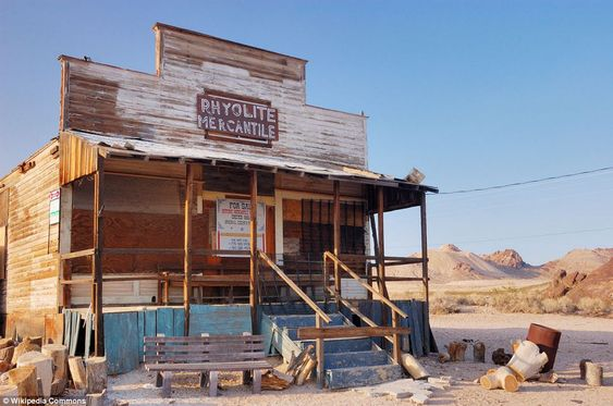 Any buyers? In Rhyolite, Nevada, which experienced a boom in the early 1990s following the discovery of gold nearby, a general store sits abandoned with a 'For Sale' sign