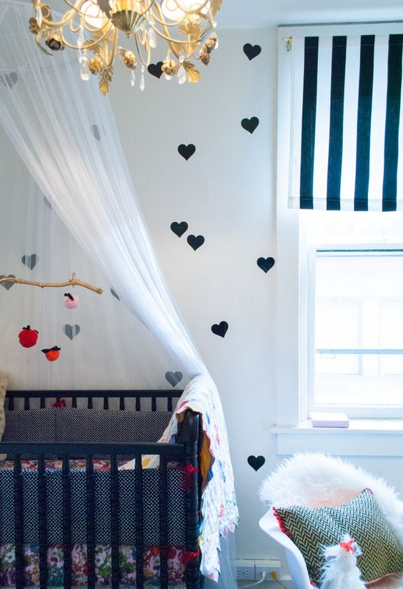 Gorgeous nursery decor - love the refurbed chandelier and bold window treatments! #babyroom