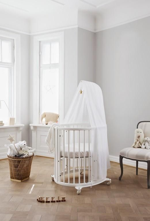 Beautiful oval shaped scandinavian designed white crib Scandinavian baby nursery